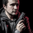 Stock Photo: Robbery, thief, armed mwith black leather jacket, dangerous