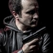 Thief, armed man with black leather jacket, dangerous — Stock Photo #38086675