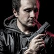 Stock Photo: Housebreaker, thief, armed mwith black leather jacket, danger