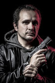 Mafia, thief, armed man with black leather jacket, dangerous — Stock Photo