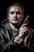 Intruder, thief, armed man with black leather jacket, dangerous — Stock Photo