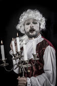 Gentleman rococo era wig, chandelier with candles — Stock Photo
