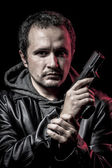 Housebreaker, thief, armed man with black leather jacket, danger — Stock Photo