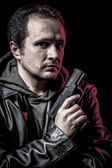 Robbery, thief, armed man with black leather jacket, dangerous — Stock Photo