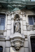Statue on building in Madrid — Stock Photo