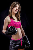 Sport, strong woman athlete with boxing gloves — Foto Stock