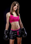 Fighting, strong woman athlete with boxing gloves — Stock Photo