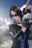 Girl with katana sword. — Stock fotografie
