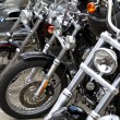 Stock Photo: Motorbike's chromed engine. Bikes in street