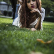 Girl lays on grass — Stock Photo #40180831