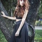 Beautiful girl in autumn park — Stock Photo #40181095