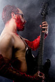 Guitarist wearing red leather — Stok fotoğraf