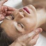 Sexy brunette girl enjoying massage — Stock Photo