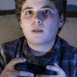 Boy with joystick playing game — Stock Photo #40626863