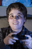 Boy with joystick playing game — Stock Photo