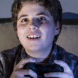 Boy with joystick playing game — Stock Photo #40634845