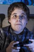 Boy with joystick playing game — Zdjęcie stockowe