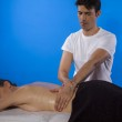 Masseur doing massage — Stock Photo