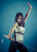 Brunette woman holding a katana sword — Stock Photo
