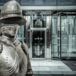 Medieval armor protecting business building — Stock Photo #41391335