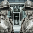 Medieval armor protecting business building — Stock Photo #41391345