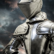 Stock Photo: Medieval armor over clouds background