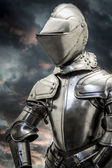 Medieval armor over clouds background — Stock Photo