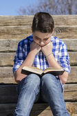 Boy reading a book in the Park — Stock Photo