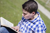Young man reading a book — Stock Photo