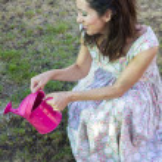 Woman watering green garden — Stock Photo #41509239