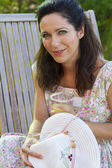 Woman drink juice in her backyard — Foto de Stock