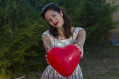 Woman with a red heart — Stock Photo