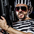 Stock Photo: Mholding machine gun