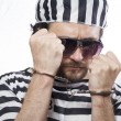 Man prisoner in prison garb — Stock Photo #41632965
