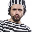 Постер, плакат: Man prisoner in prison garb