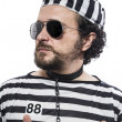 Man prisoner in prison garb — Stock Photo #41633561