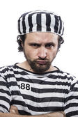 Man prisoner in prison garb — Stockfoto