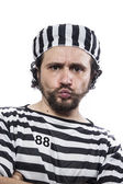 Man prisoner in prison garb — Stockfoto