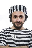 Man prisoner in prison garb — Stock Photo