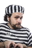 Man prisoner in prison garb — Stock fotografie