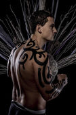 Young man with tribe tattoo — Stock Photo