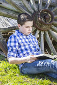 Young boy reading a book — Stock Photo