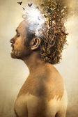 Man covered in mud — Stock Photo