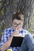 Young boy reading a book — Stock Photo