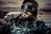Pilot with black leather jacket — Stock Photo