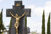 Jesus Christ on the cross in a cemetery — Stock Photo