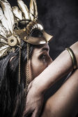 Woman with golden mask jewelry — Stock Photo