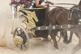 Roman chariot in a fight of gladiators — Stock Photo