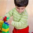 Boy playing with plastic blocks — Stock Photo #46077341
