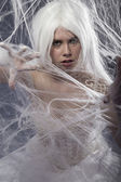 Woman trapped in spider web — Stock Photo